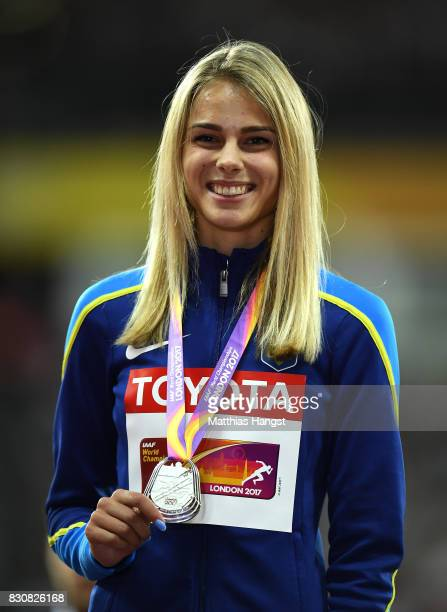 Yuliia Levchenko of Ukraine silver poses with her medals for the Women's High Jump Final during day nine of the 16th IAAF World Athletics...