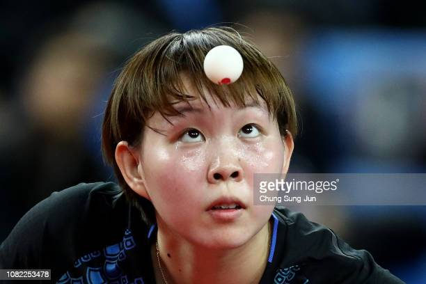 Yuling Zhu of China competes in the Women's Singles Round of 16 against Hitomi Sato of Japan during day two of the World Tour Grand Finals at Namdong...