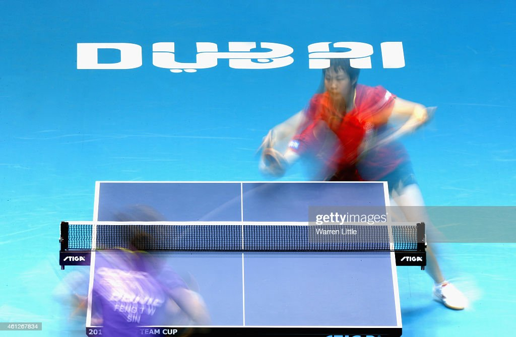 Yuling Zhu of China in action against Tianwei Feng of Singapore during the semi finals of the 2015 IFFT World Team Cup at the Al Nasr Stadium on January 10, 2015 in Dubai, United Arab Emirates.