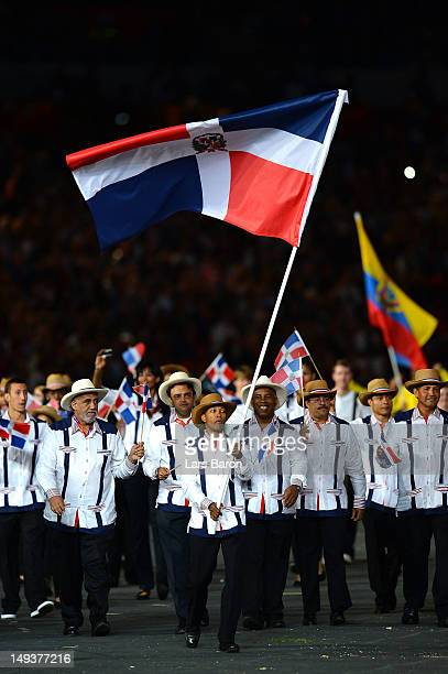 Yulis Mercedes Reyes of the Dominican Republic taekwondo team carries his countires flag during the Opening Ceremony of the London 2012 Olympic Games...