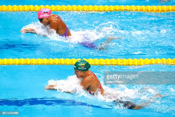 Yuliya Efimova of Russia and Ruta Meilutyte of Lithuania competes during the Women's 100m Breaststroke Heats on day eleven of the Budapest 2017 FINA...