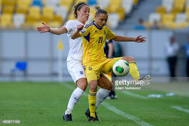 Yuliya Korniyevets of Ukraine Women fights for the ball with Lucia Bronze of England Women during the FIFA Women's World Cup 2015 Qualifier match...