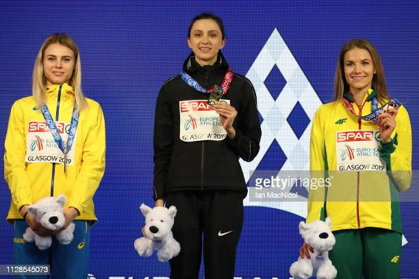 Yuliya Levchenko of Ukraine Mariya Lasitskene of Russia and Airine Palsyte of Lithuania with their medals during the medal ceremony for the women's...
