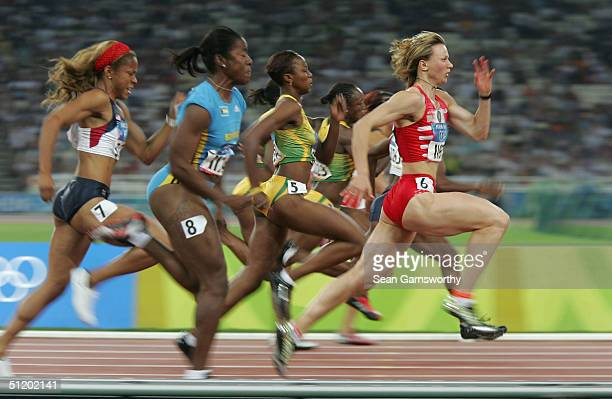 Yuliya Nesterenko of Belarus competes in the women's 100 metre final on August 21, 2004 during the Athens 2004 Summer Olympic Games at the Olympic...