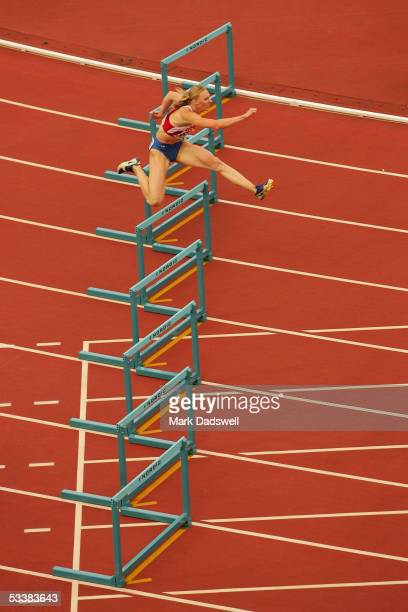 Yuliya Pechonkina of Russia competes during the women's 400 metres hurdles final at the 10th IAAF World Athletics Championships on August 13, 2005 in...