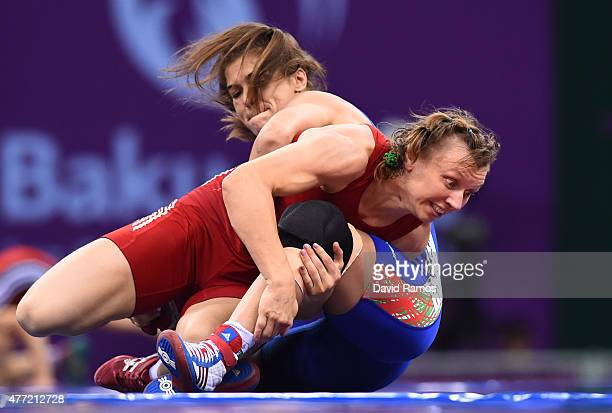 Yuliya Ratkevich of Azerbaijan and Taybe Yusein of Bulgaria compete in the Women's wrestling 60kg Freestyle 1/8 final match during day three of the...