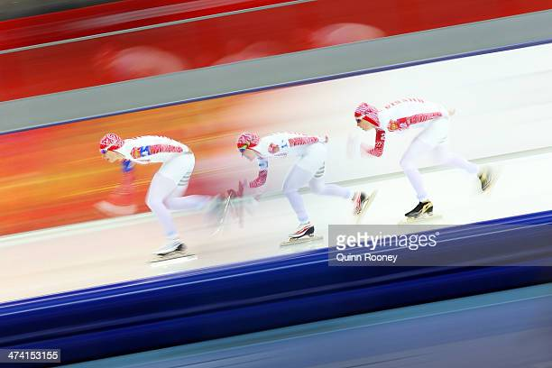 Yuliya Skokova Olga Graf and Yekaterina Lobysheva of Russia compete during the Women's Team Pursuit Final B Speed Skating event on day fifteen of the...