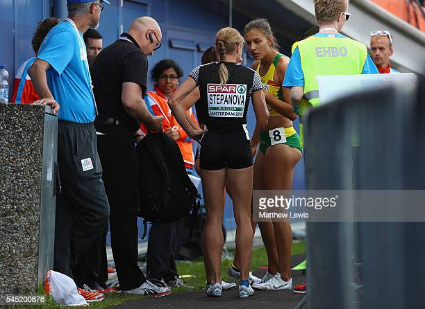 Yuliya Stepanova talks to her fellow athletes after finishing last in the Womens 800m heats during day one of the 23rd European Athletics...
