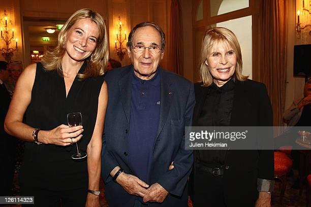 Yuliya Vysotskaya Robert Hossein and his wife Candice Patou attend the Andrei Konchalovsky Chevalier de la Legion d'Honneur ceremony at Hotel Bristol...
