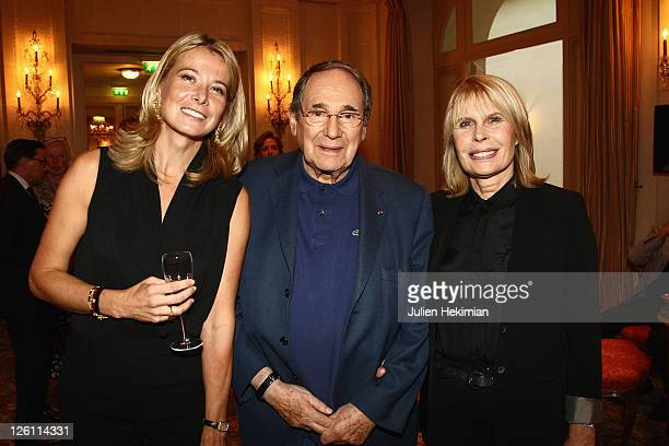 Yuliya Vysotskaya, Robert Hossein and his wife Candice Patou attend the Andrei Konchalovsky Chevalier de la Legion d'Honneur ceremony at Hotel...