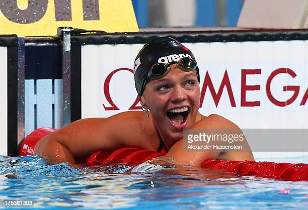 Yuliya Yefimova of Russia celebrates her new world record after the Swimming Women's 50m Breaststroke preliminaries heat eight on day fifteen of the...