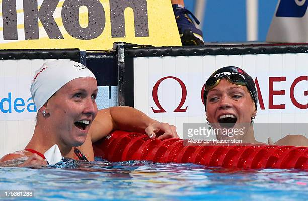 Yuliya Yefimova of Russia celebrates her new world record with Jessica Hardy of the USA after the Swimming Women's 50m Breaststroke preliminaries...