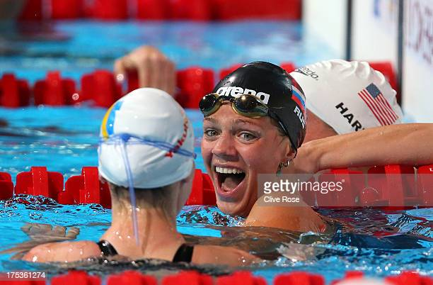 Yuliya Yefimova of Russia celebrates her new world record with Mariia Liver of the Ukraine after the Swimming Women's 50m Breaststroke preliminaries...