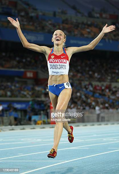 Yuliya Zaripova of Russia celebrates claiming gold in the women's 3000 metres steeplechase final during day four of the 13th IAAF World Athletics...