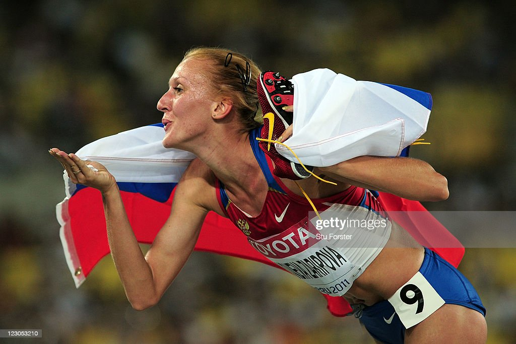 Yuliya Zaripova of Russia celebrates claiming gold in the women's 3000 metres steeplechase final during day four of the 13th IAAF World Athletics Championships at the Daegu Stadium on August 30, 2011 in Daegu, South Korea.