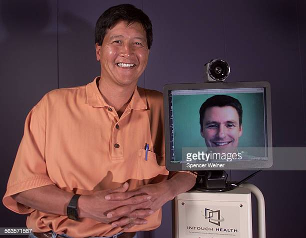 Yulun Wang CEO of InTouch Health with Vice President–Engineering Steve Jordan on Video monitor InTouch a Santa Barbara robotic company whose product...