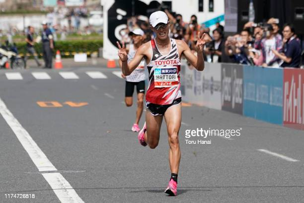 Yuma Hattori of Japan celebrates as he crosses the finish line to take second place as Suguru Osako is seen on the background during the Marathon...