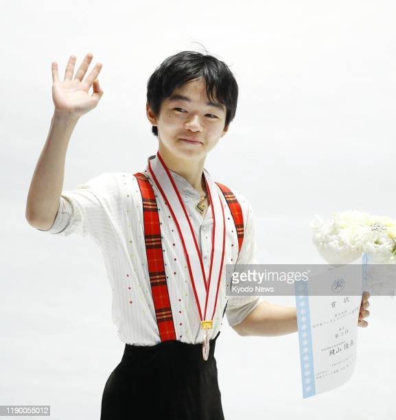 Yuma Kagiyama waves after winning bronze at the national figure skating championships on Dec 22 at Yoyogi National Gymnasium in Tokyo