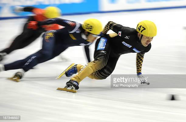 Yuma Sakurai of Japan followed by YunJae Kim of Korea in Race 3 of Men 1500m Semifinals during day three of the ISU World Cup Short Track at Nippon...