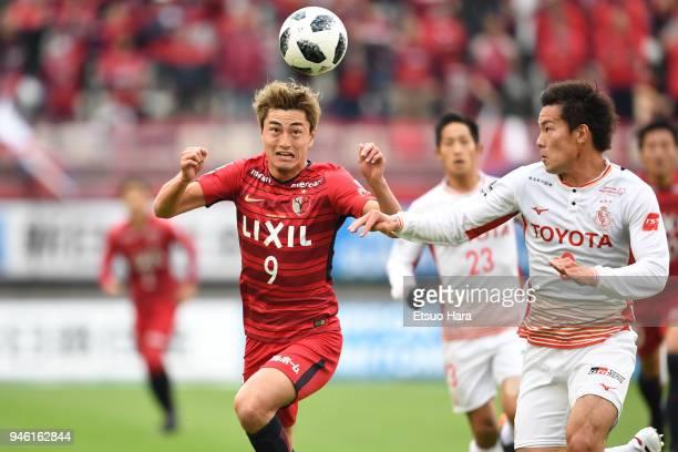 Yuma Suzuki of Kashima Antlers and Kazuki Kushibiki of Nagaya Grampus compete for the ball during the J.League J1 match between Kashima Antlers and...