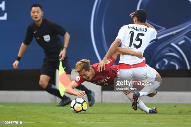 Yuma Suzuki of Kashima Antlers and Mohammad Ansari of Persepolis compete for the ball during the AFC Champions League final first leg match between...