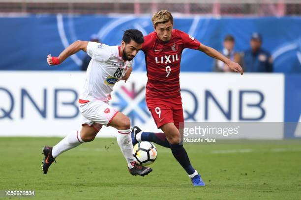 Yuma Suzuki of Kashima Antlers and Siamak Nemati of Persepolis compete for the ball during the AFC Champions League final first leg match between...
