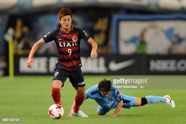 Yuma Suzuki of Kashima Antlers and Tatsuya Hasegawa of Kawasaki Frontale compete for the ball during the J.League J1 match between Kashima Antlers...