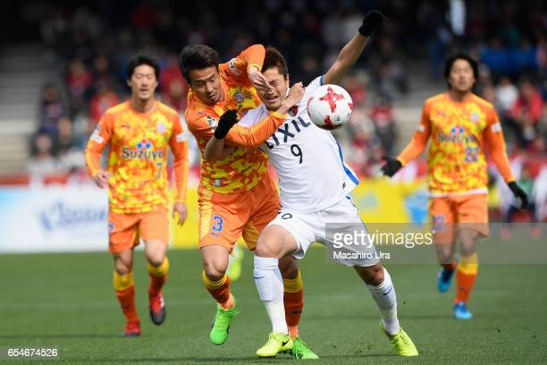 Yuma Suzuki of Kashima Antlers and Tomoya Inukai of Shimizu S-Pulse compete for the ball during the J.League J1 match between Shimizu S-Pulse and...