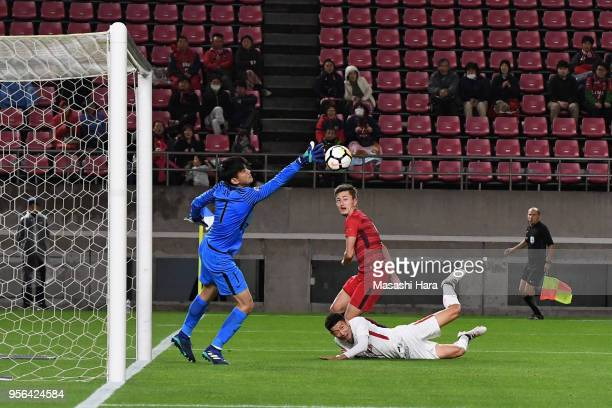 Yuma Suzuki of Kashima Antlers and Yu Hai of Shanghai SIPG collide resulting in the own goal during the AFC Champions League Round of 16 first leg...