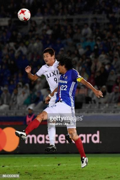 Yuma Suzuki of Kashima Antlers and Yuji Nakazawa of Yokohama FMarinos compete for the ball during the JLeague J1 match between Yokohama FMarinos and...