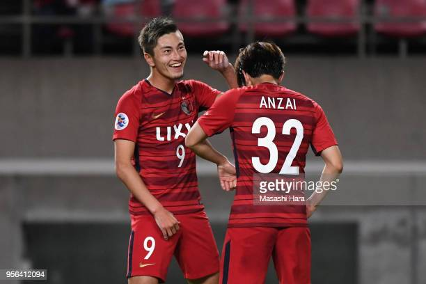 Yuma Suzuki of Kashima Antlers celebrates his side's third goal with his team mate Koki Anzai during the AFC Champions League Round of 16 first leg...