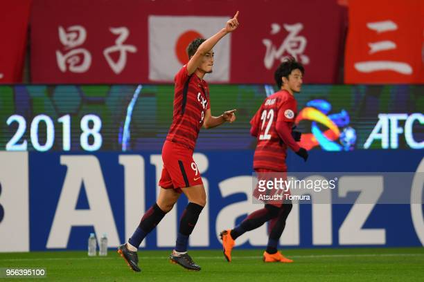 Yuma Suzuki of Kashima Antlers celebrates scoring the opening goal during the AFC Champions League Round of 16 first leg match between Kashima...