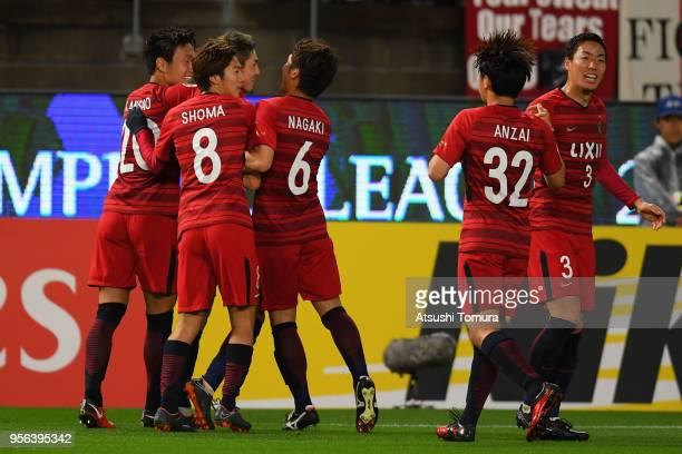 Yuma Suzuki of Kashima Antlers celebrates scoring the opening goal with his team mates during the AFC Champions League Round of 16 first leg match...