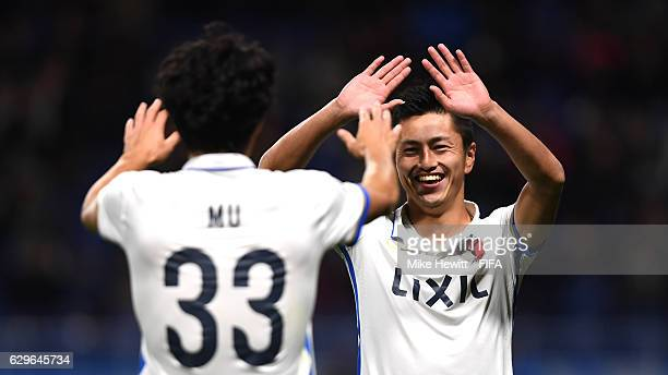Yuma Suzuki of Kashima Antlers celebrates with Mu Kanazaki of Kashima Antlers after scoring his sides third goal during the FIFA Club World Cup Semi...