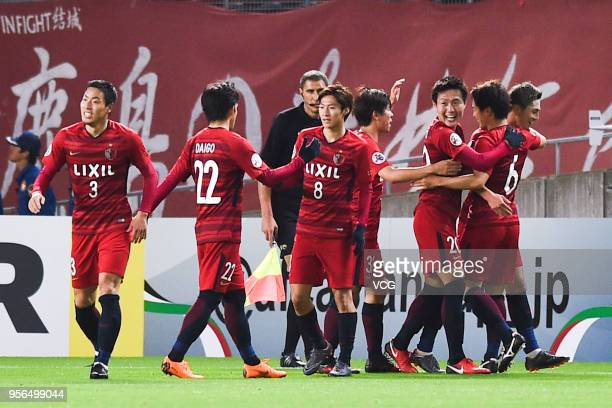 Yuma Suzuki of Kashima Antlers celebrates with team mates after scoring his team's first goal during the AFC Champions League Round of 16 first leg...