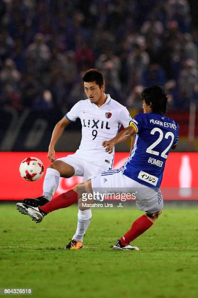 Yuma Suzuki of Kashima Antlers controls the ball under pressure Yuji Nakazawa of Yokohama FMarinos during the JLeague J1 match between Yokohama...