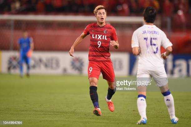 Yuma Suzuki of Kashima Antlers exchanges words with Ku Jaryong of Suwon Samsung Bluewings during the AFC Champions League semi final first leg match...