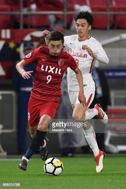 Yuma Suzuki of Kashima Antlers goes past Zhang Yi of Shanghai SIPG during the AFC Champions League Round of 16 first leg match between Kashima...