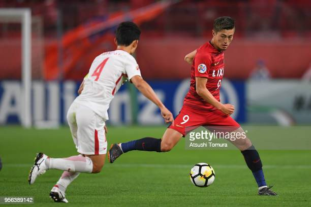 Yuma Suzuki of Kashima Antlers takes on Wang Shenchao of Shanghai SIPG during the AFC Champions League Round of 16 first leg match between Kashima...