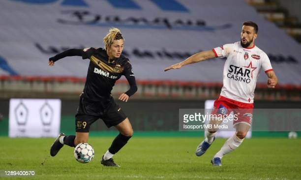 Yuma Suzuki of STVV battles for the ball with Matias Silvestre of Mouscron during the Jupiler Pro League match between Royal Excel Mouscron and STVV...