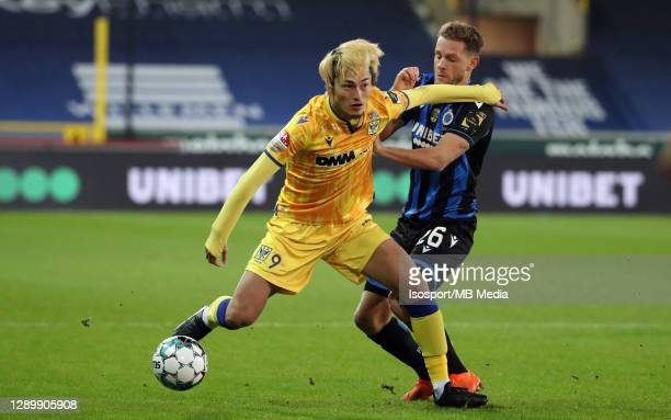 Yuma Suzuki of STVV battles for the ball with Mats Rits of Club Brugge during the Jupiler Pro League match between Club Brugge and STVV at Jan...