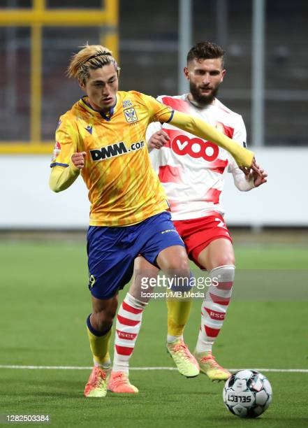 Yuma Suzuki of STVV battles for the ball with Nicolas Gavory of Standard during the Jupiler Pro League match between STVV and Standard de Liege at...