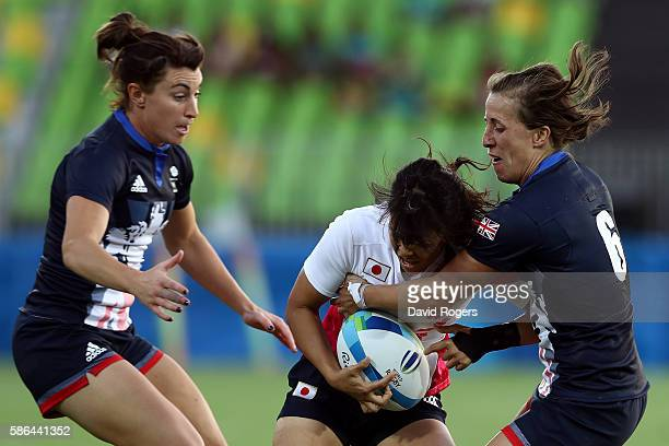 Yume Okuroda of Japan and Katy Mclean of Great Britain compete for the ball during a Women's Pool C rugby match between Great Britain and Japan on...