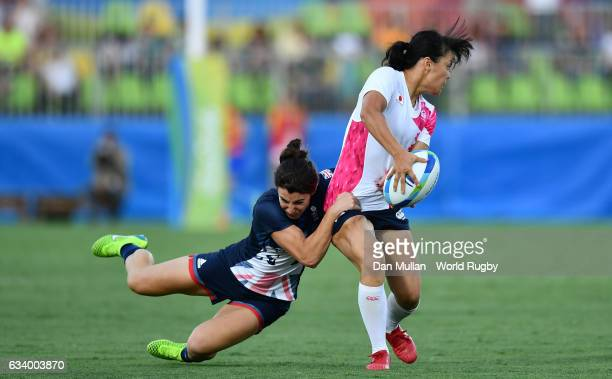 Yume Okuroda of Japan is tackled by Alice Richardson of Great Britain during the Women's Rugby Sevens Pool C match between Great Britain and Japan on...