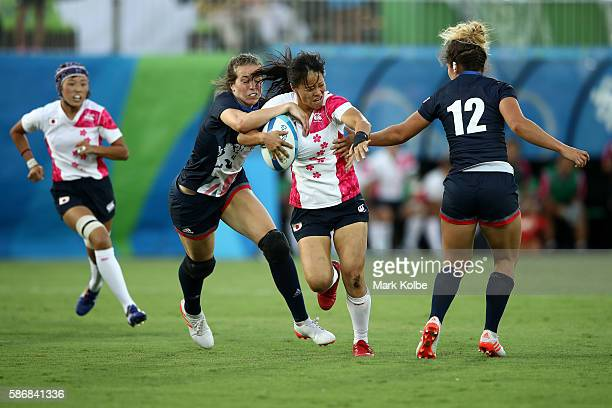Yume Okuroda of Japan is tackled during a Women's Pool C rugby match between Great Britain and Japan on Day 1 of the Rio 2016 Olympic Games at...