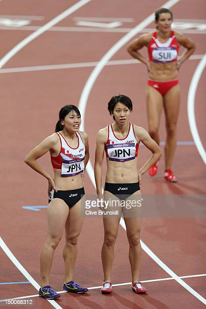 Yumeka Sano of Japan and Chisato Fukushima of Japan speak after competing in the Women's 4 x 100m Relay Round 1 on Day 13 of the London 2012 Olympic...
