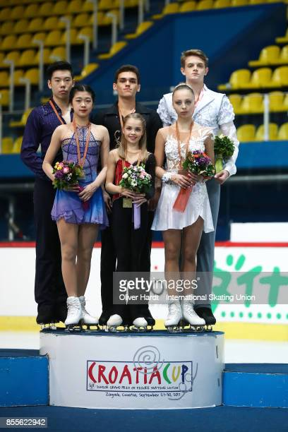 Yumeng Gao and Zhong Xie of China with the silver medal, Polina Kostiukovich and Dmitrii Ialin of Russia with the gold medal and Aleksnadra Boikova...