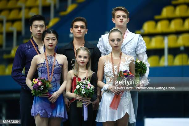 Yumeng Gao and Zhong Xie of China with the silver medal Polina Kostiukovich and Dmitrii Ialin of Russia with the gold medal and Aleksnadra Boikova...