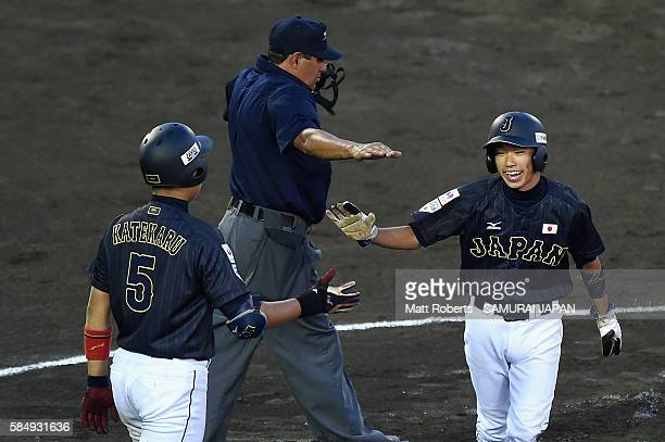 Yumeto Taguchi of Japan celebrates as he crosses the plate with Shota Katekaru in the top half of the second inning in the game between Czech...