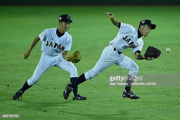 Yumeto Taguchi of Japan fumbles the ball in the outfield in the top half of the nineth inning in the super round game between Japan and Venezuela...